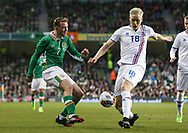 Aidan McGeady of Republic of Ireland and Hordur Bjorgvin Magnusson of Iceland during the International Friendly match at the Aviva Stadium, Dublin<br /> Picture by Lorraine O'Sullivan/Focus Images Ltd +353 872341584<br /> 28/03/2017
