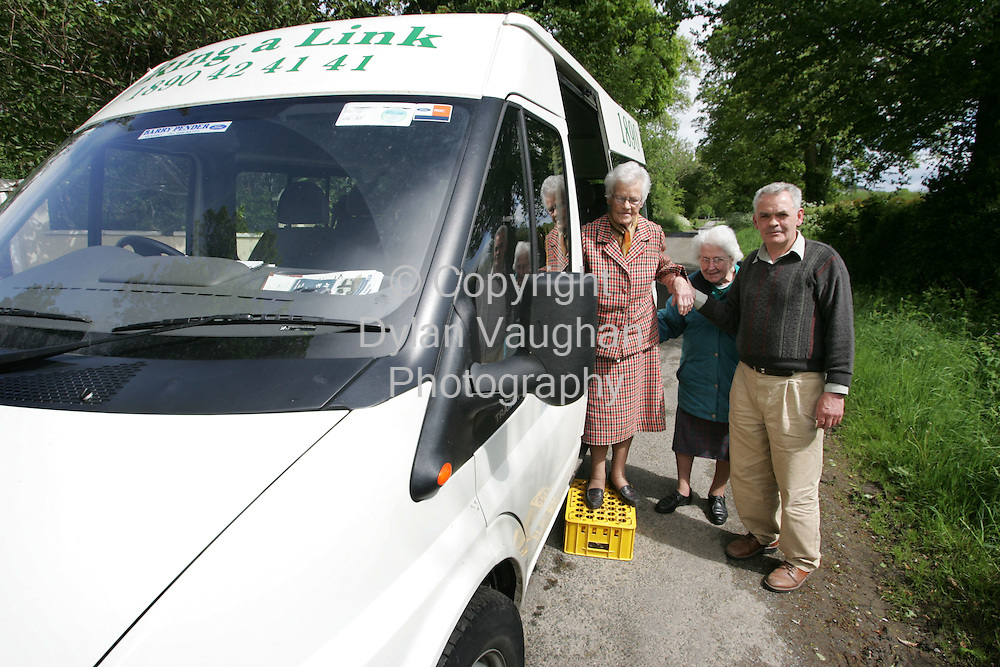 19/5/2006.Tommy Forristal helps Hannah Finn from Kilcash (left) and Mary Foley from Owning off the Ring a Link bus at Whitechurch near Owning in south Kilkenny..Picture Dylan Vaughan.