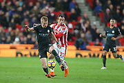 Oleksandr Zinchenko and Xherdan Shaqiri during the Premier League match between Stoke City and Manchester City at the Bet365 Stadium, Stoke-on-Trent, England on 12 March 2018. Picture by Graham Holt.