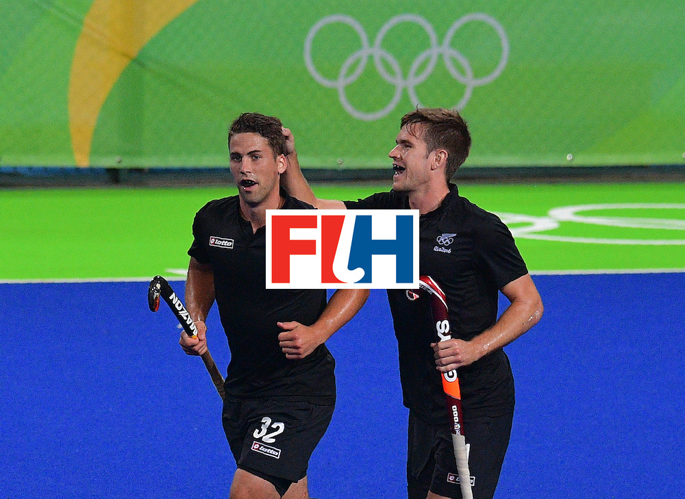 New Zealand's Nick Wilson (L) celebrates a goal with New Zealand's James Coughlan during the men's field hockey New Zealand vs Brazil match of the Rio 2016 Olympics Games at the Olympic Hockey Centre in Rio de Janeiro on August, 10 2016. / AFP / Carl DE SOUZA        (Photo credit should read CARL DE SOUZA/AFP/Getty Images)