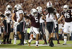 Texas A&M running back Trayveon Williams (5) reacts after scoring a touchdown during the first quarter of an NCAA college football game against South Carolina Saturday, Sept. 30, 2017, in College Station, Texas. (AP Photo/Sam Craft)