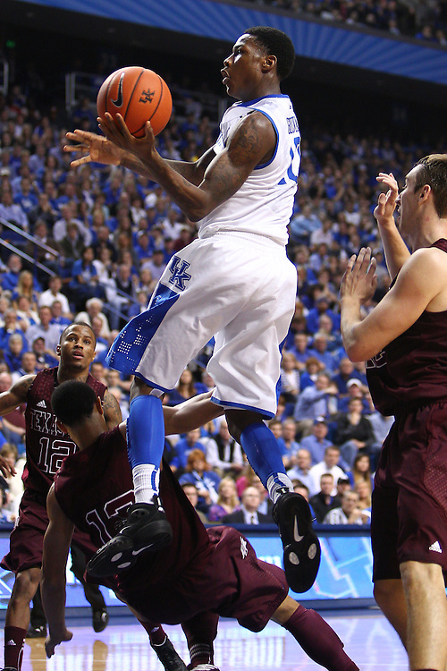 UK guard Archie Goodwin, center, drives to the basket int he first half with pressure from Texas A&M guard Jordan Green. The University of Kentucky Men's Basketball team hosted Texas A&M , Saturday, Jan. 12, 2013 at Rupp Arena in Lexington . Photo by Jonathan Palmer/Special to the Courier-Journal.