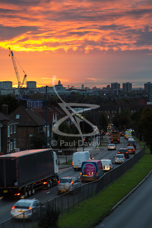 London, October 23 2017. As the sun rises on day one of London's new anti-pollution T-Charge, cars, trucks and vans stream into the capital on the A40, one of the busiest arterial roads. © Paul Davey