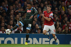 LONDON, ENGLAND - Oct 01: Napoli's defender Camilo Zuniga from Columbia  and Arsenal's midfielder Aaron Ramsey from Wales  during the UEFA Champions League match between Arsenal from England and Napoli from Italy played at The Emirates Stadium, on October 01, 2013 in London, England. (Photo by Mitchell Gunn/ESPA)