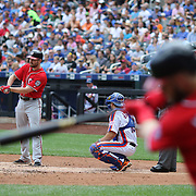 NEW YORK, NEW YORK - July 10: Daniel Murphy #20 of the Washington Nationals batting as Bryce Harper #34 of the Washington Nationals practices his swing on deck during the Washington Nationals Vs New York Mets regular season MLB game at Citi Field on July 10, 2016 in New York City. (Photo by Tim Clayton/Corbis via Getty Images)