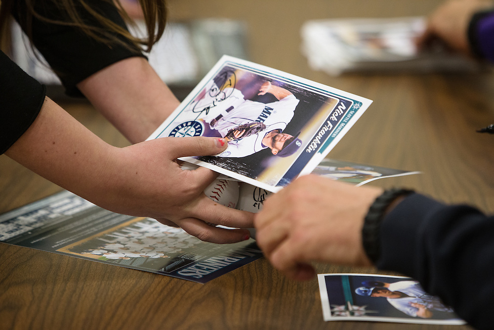 GABE GREEN/Press<br /> <br /> Kids at Boys and Girls Club of Post Falls stood in line to get autographs from Mariners second baseman and infielder Nick Franklin along and announcer Mike Blowers.