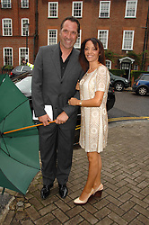 DAVID & DEBBIE SEAMAN at the annual Sir David & Lady Carina Frost Summer Party in Carlyle Square, London SW3 on 5th July 2007.<br />