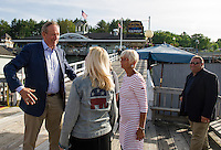 Former Governor of NY George Pataki talks with Patti Page and Jan Face Glassman prior to boarding the M/S Mt Washington on Friday evening for the Belknap County Republican cruise.  (Karen Bobotas/for the Laconia Daily Sun)