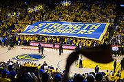 "A ""Strength in Numbers"" banner flies over the fans during Game 1 of the NBA Finals between Golden State Warriors and Cleveland Cavaliers at Oracle Arena in Oakland, Calif., on June 1, 2017. (Stan Olszewski/Special to S.F. Examiner)"