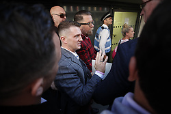 © Licensed to London News Pictures . 27/09/2018. London, UK. Former  EDL leader Tommy Robinson (real name Stephen Yaxley-Lennon ) leaves the Old Bailey , after his retrial for Contempt of Court following his actions outside Leeds Crown Court in May 2018 . Robinson was already serving a suspended sentence for the same offence when convicted in May and served time in jail as a consequence , but the newer conviction was quashed by the Court of Appeal and a retrial ordered . Photo credit: Peter Macdiarmid/LNP