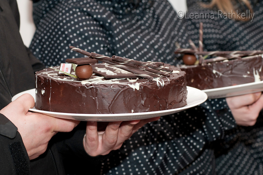 Swiss athletes are awarded a chocolate cake after winning a medal at the House of Switzerland in Whistler during the 2010 Olympic Winter games in Whistler, BC Canada.