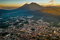 Aerial view of Antigua Guatemala at sunrise with volcanoes Fuego (left peak) and Acatenango on Thursday, Oct. 26, 2018.