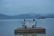 China Out<br /> <br />  Floating Restaurant<br /> <br /> Two customers have meal on a floating restaurant at a scenic spot on August 7, 2015 in Lin'an, Zhejiang Province of China. A scenic spot in south China's Lin'an in Zhejiang Province opened floating restaurant that visitors could enjoy their meals on the water. <br /> ©Exclusivepix Media