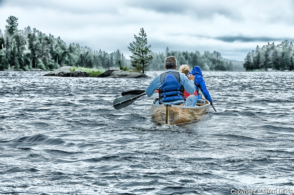 Paddling into a storm, Boundary Waters. Artistic impression.