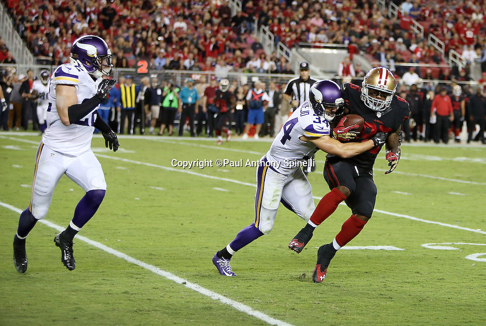 San Francisco 49ers tight end Vernon Davis (85) catches a second quarter pass for a first down as he gets hit by Minnesota Vikings strong safety Andrew Sendejo (34) during the 2015 NFL week 1 regular season football game against the Minnesota Vikings on Monday, Sept. 14, 2015 in Santa Clara, Calif. The 49ers won the game 20-3. (©Paul Anthony Spinelli)
