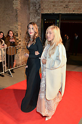 Left to right, CARA DELEVINGNE and ELLIE GOULDING at 'The World's First Fabulous Fund Fair' in aid of the Naked Heart Foundation hosted by Natalia Vodianova and Karlie Kloss at The Roundhouse, Chalk Farm Road, London on 24th February 2015.