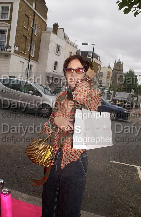 Lucy Ferry, Diane von Furstenberg shop opening, Ledbury Rd. 21 September 2003. © Copyright Photograph by Dafydd Jones 66 Stockwell Park Rd. London SW9 0DA Tel 020 7733 0108 www.dafjones.com