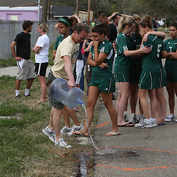 (Shot on March 6, 2009) Kenneth Schexnayder pours water on the pavement where three Southeastern University students were run over by a drunk driver as fellow students mourn the loss of those that were killed while walking home shortly after 2:00am on the morning of March 6, 2008 on Nashville Street in Hammond, Louisiana after a drunk driver hit five students killing three and critically injuring one and leaving one student with minor injuries, the driver identified as 21-year-old Derek Quebedeaux also a Southeastern student was arrested by Hammond Police.. (Photo by: Derick Hingle)