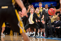 Iowa head coach Fran McCaffery and his team celebrate in the waning seconds of their win over Maryland in the NIT Semifinals at Madison Square Garden.
