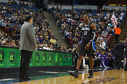Jan 8, 2012; Sacramento, CA, USA; Orlando Magic center Dwight Howard (12) walks towards head coach Stan Van Gundy (left) during the first quarter against the Sacramento Kings at Power Balance Pavilion. Orlando defeated Sacramento 104-97. Mandatory Credit: Jason O. Watson-US PRESSWIRE