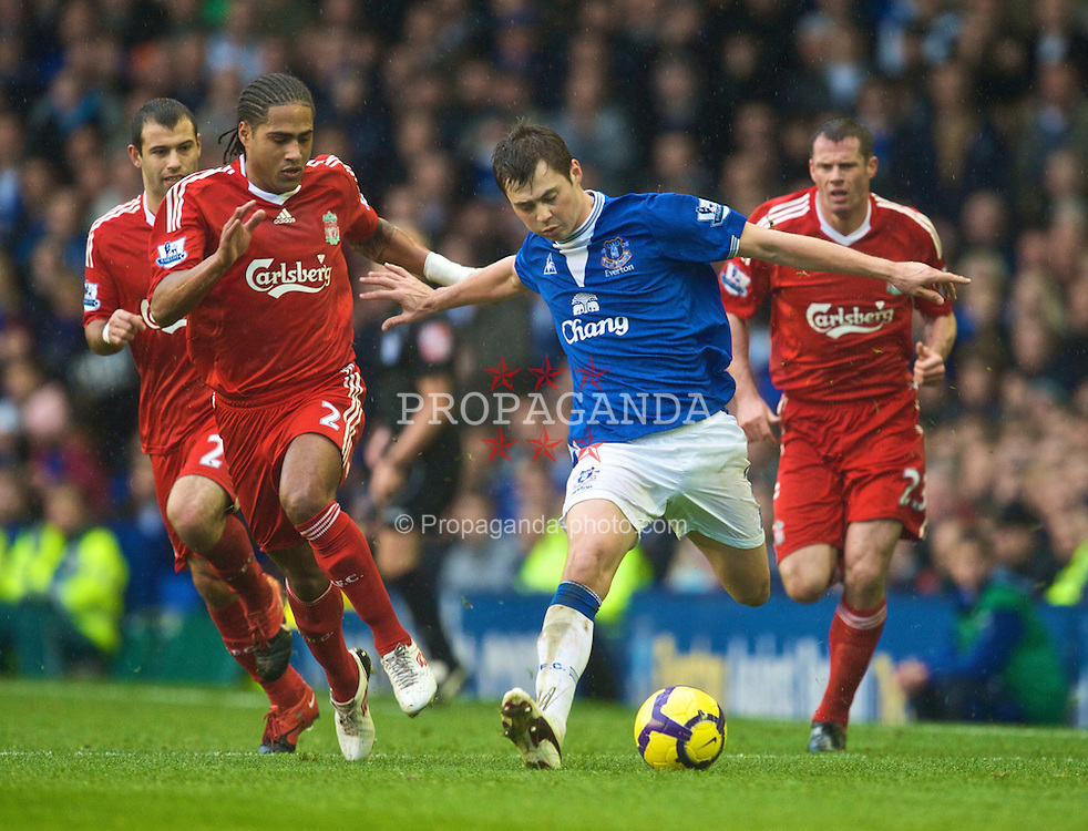LIVERPOOL, ENGLAND - Sunday, November 29, 2009: Liverpool's Javier Mascherano, Glen Johnson and Jamie Carragher and Everton's Diniyar Bilyaletdinov during the Premiership match at Goodison Park. The 212th Merseyside Derby. (Photo by David Rawcliffe/Propaganda)