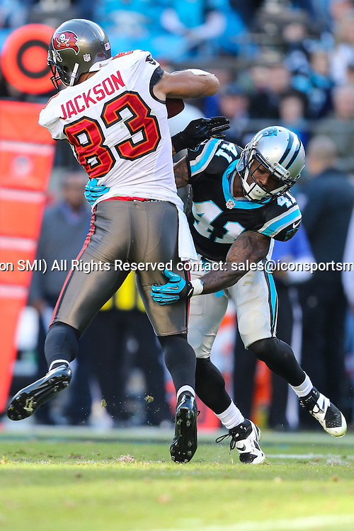 December 1, 2013: Carolina Panthers cornerback Captain Munnerlyn (41) upends Tampa Bay Buccaneers wide receiver Vincent Jackson (83) during game action at Bank of America Stadium in Charlotte, NC. The Panthers win 27-6 over the Buccaneers.