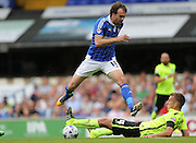 Ipswich Town striker Brett Pitman evades a challenge during the Sky Bet Championship match between Ipswich Town and Brighton and Hove Albion at Portman Road, Ipswich, England on 29 August 2015.