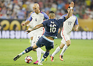 HOUSTON, TEXAS - JUNE 21: Michael Bradley #4 of United States is stopped by Marcos Rojo #16 of Argentina during play in the second half before the Semifinal match between Argentina and US at NRG Stadium as part of Copa America Centenario US 2016 on June 21, 2016 in Houston, Texas, US. (Photo by Thomas B. Shea/LatinContent/Getty Images)
