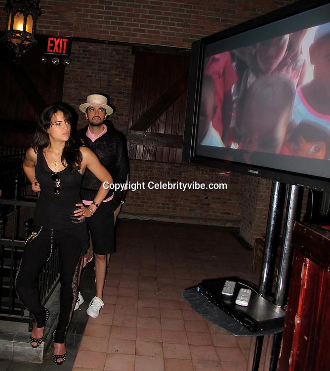 Michelle Rodriguez & John Legend at Edeyo Third Anniversary