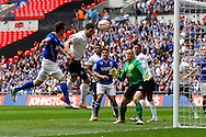 Sam Hird of Chesterfield (left) puts his header wide during the Johnstone's Paint Trophy Final match at Wembley Stadium, London<br /> Picture by David Horn/Focus Images Ltd +44 7545 970036<br /> 30/03/2014