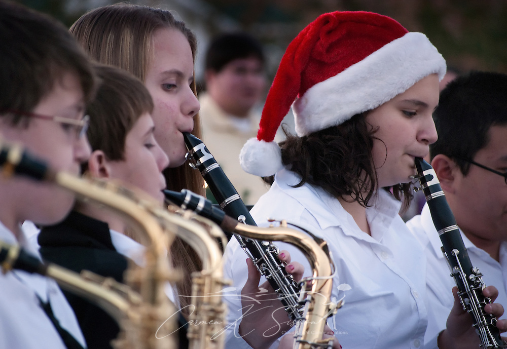 Sarah McGallagher (right) performs with the Alba Middle School Jazz Band during the annual Christmas tree lighting ceremony Dec. 4, 2010 in Bayou La Batre, Ala. Members of the ALBA Club and the Bayou La Batre City Council participated in the evening's festivities. (Photo by Carmen K. Sisson/Cloudybright)