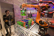 Hannover Messe 2005, the biggest annual industrial fair in the World..Siemens Industrial. Robot transferring crates with soft drinks.