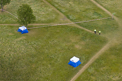 © Licensed to London News Pictures. 08/06/2020. London, UK. Police officers guard forensics tents at Fryent Country Park near Wembley, north London. According to reports, two women were found unresponsive and were pronounced dead at the scene yesterday. Photo credit: Peter Macdiarmid/LNP