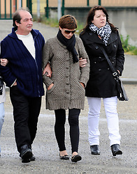 Pic Shows: Stephanie Morlet and her family. The mother of murdered Mathew (10) and Carla (5) Stevenson. Arriving at the school where the children attended. Charantonnay, Lyon, France. In a suspected double murder, 10-year-old Mathew and five-year-old Carla are said to have had their throats cut by their father, Julian Stevenson, May 21, 2013. Photo by: i-Images