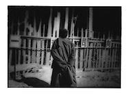 Tibetan Buddhist monk surveys new construction in central  Gyeltangteng, Kham (Zhongdian, Shangri-la County, Yunnan).