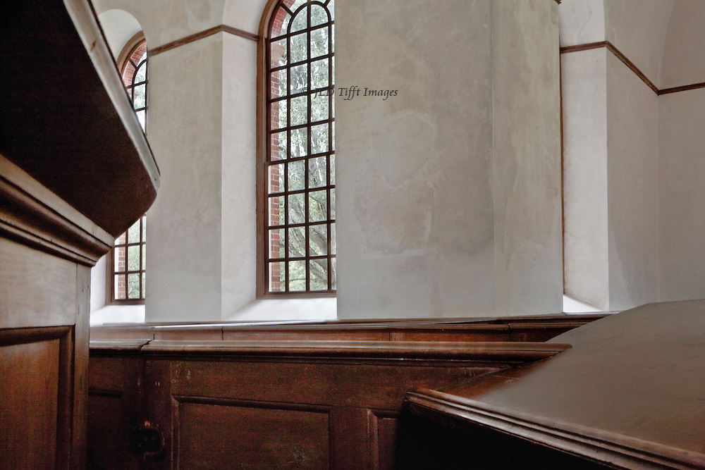"""Perfect American Georgian brick church, funded by Robert """"King"""" Carter in 1735.  Central plan, carved walnut pews and pulpit.  This view at the interior crossing includes parts of pew and pulpit to frame three of its arched and mullioned windows.  The image as a result balances three dimensional space with two dimensional graphic design.  Carefully preserved and devotedly maintained by a private organization."""