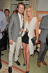 EMMA NOBLE and her husband CONRAD BAKER at The House of Britannia reception hosted by Lady Delves Broughton at 42 Berkeley Square, London on 26th June 2014.