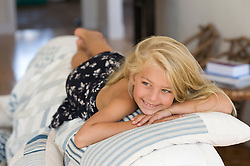 little girl enjoying time at home on top of a couch in The Hamptons