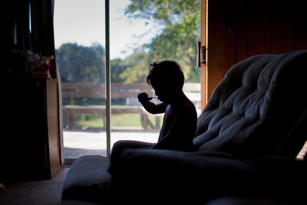 Jojo eats breakfast on the couch.