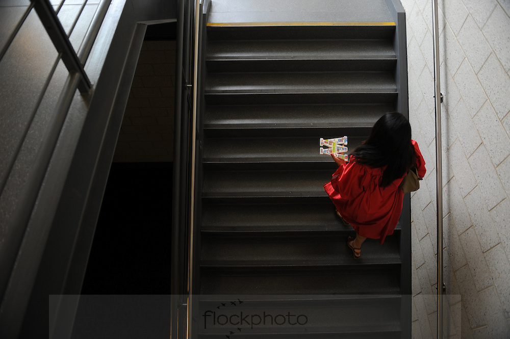 A Wellesley High School senior climbs the stairs to join her classmates before the class of 2016 graduation ceremony, June 3, 2016.<br /> Wicked Local staff photo / Kate Flock