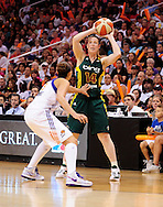 Sep 17, 2011; Phoenix, AZ, USA; Seattle Storm  guard Katie Smith (14) handles the ball against the Phoenix Mercury guard Diana Taurasi (3) during the second half at the US Airways Center.  The Mercury defeated the Storm 92 - 83. Mandatory Credit: Jennifer Stewart-US PRESSWIRE