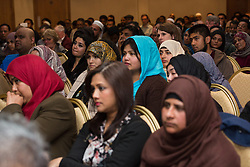 © Licensed to London News Pictures. 01/05/2015. London, UK. Crowds of supporters at a public meeting held at the Waterlily in Stepney, east London on 30th April 2015. The meeting was ex Mayor of Tower Hamlets, Lutfur Rahman's first public appearance after being found guilty of electoral fraud last week and called for attendees to donate money to a legal fund to facilitate an appeal against the High Court ruling. Photo credit : Vickie Flores/LNP