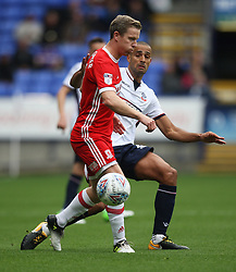 Grant Leadbitter of Middlesbrough (L) and Darren Pratley of Bolton Wanderers in action - Mandatory by-line: Jack Phillips/JMP - 09/09/2017 - FOOTBALL - Macron Stadium - Bolton, England - Bolton Wanderers v Middlesbrough - English Football League Championship