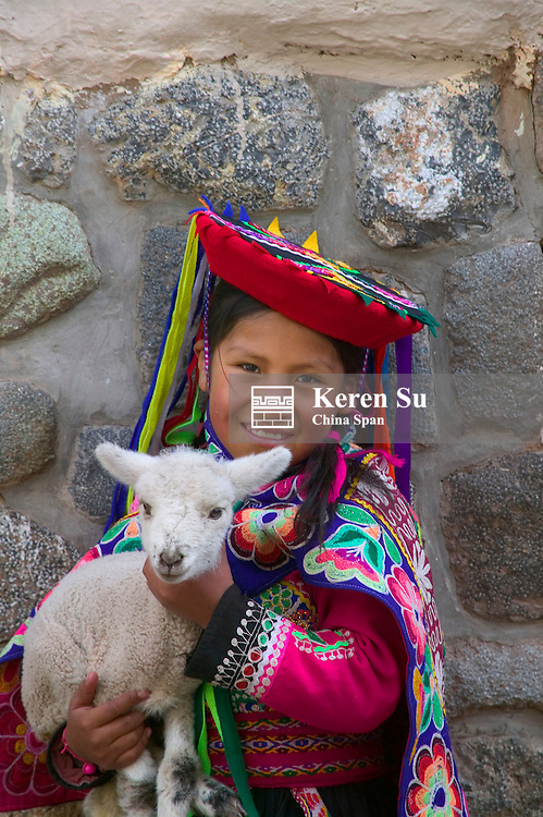 Indian girl holding baby lamb, Cuzco, Peru