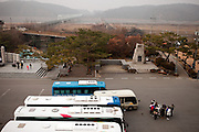 "Imjingak/South Korea, Republic Korea, KOR, 28.11.2009: Tourists are waiting to board their busses  at Imjingak, located 7 km from the Military Demarcation Line, which is now at the forefront of tourism related to the Korean Conflict. It was built in 1972 with the hope that someday unification would be possible. In the back the so called ""Bridge of Freedom""."