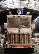 SHENYANG, CHINA - DECEMBER 03: (CHINA OUT) <br /> <br /> Carpenter Makes Home-made Electric Wooden Armoured Vehicle<br /> <br /> Liu Fulong, a 48-year-old carpenter assembles his electric wooden armoured vehicle on December 3, 2014 in Shenyang, Liaoning province of China. Chinese carpenter Liu Fulong worked out a home-made electric wooden armoured vehicle which was installed missile and radar in four months at his home. The armoured vehicle was in 2.5 meters long, 1.3 meters wide and over 350 kilograms weight with its fastest speed up to 50 km/h. The vehicle cost him about 20,000 RMB (about 3252 USD), much more expensive than his first homemade vehicle on October 29<br /> ©Exclusivepix Media