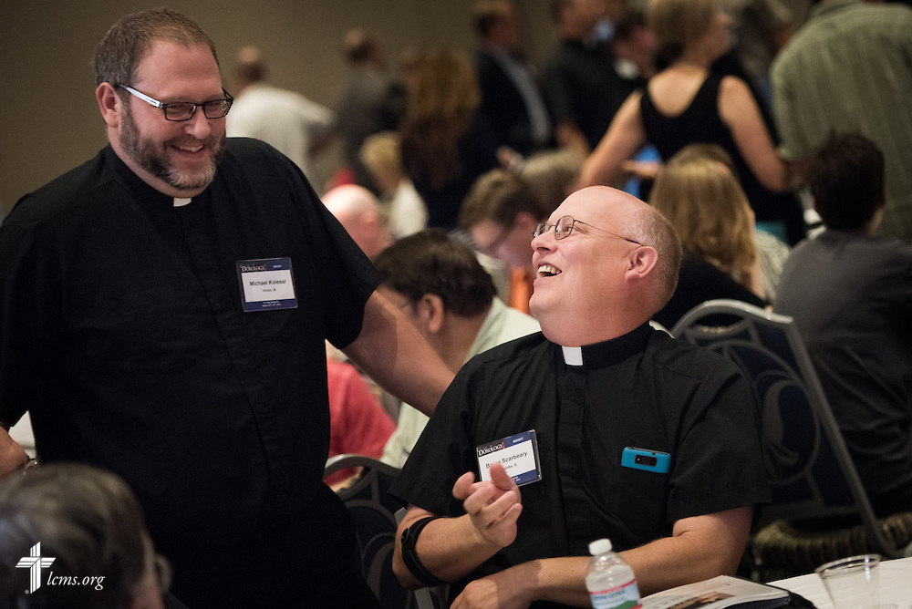 "The Rev. Michael Kolesar (left), pastor of Saint James Lutheran Church in Victor, Iowa, chats with The Rev. Bruce Scarbeary, senior pastor of Trinity Lutheran Church in Roanoke, Ill., during the DOXOLOGY event, ""Finding Our Voice,"" on Wednesday, August 12, 2015, at Saint Louis University in Midtown St. Louis. LCMS Communications/Erik M. Lunsford"