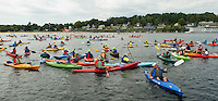 Hundreds of Lake Fest participants gather together in their attempt at the Guinness World Record on Saturday morning from Weirs Beach in Lake Winnipesaukee.  (Karen Bobotas/for the Laconia Daily Sun)