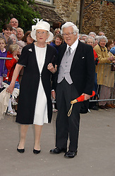 LORD & LADY HOWE at the wedding of Laura parper Bowles to Harry Lopes held at Lacock, Wiltshire on 6th May 2006.<br />