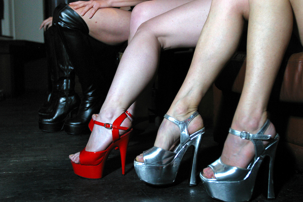 The high heel shoes of girls at a pole dancing class in a central London club.